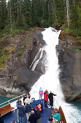 Alaska, Cruising the Southeast wilderness waterways on the Spirit of Discovery.  At Icy Falls in Tracy Arm..Photo #: alaska10433 .Photo copyright Lee Foster, 510/549-2202, lee@fostertravel.com, www.fostertravel.com..