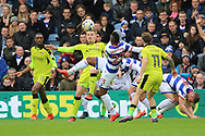 Rotherham United striker Danny Ward (9) battles for possession with Queens Park Rangers midfielder Yeni Atito Ngbakoto (23) during the EFL Sky Bet Championship match between Queens Park Rangers and Rotherham United at the Loftus Road Stadium, London, England on 18 March 2017. Photo by Matthew Redman.