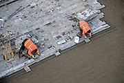 Nederland, Nijmegen, 13-12-2013Het vernieuwde plein 44 is klaar. De eerste bewoners en winkels nemen hun intrek. Stratenmakers leggen de laatste stenen.Foto: Flip Franssen/Hollandse Hoogte