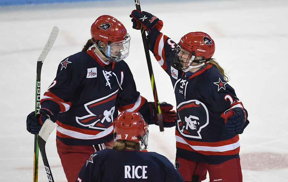 STATE COLLEGE, PA - FEBRUARY 05: Ellie Marcovsky #23 of the Robert Morris Colonials celebrates with Emilie Harley #22 and Wasyn Rice #7 after scoring a goal in the first period during the game against the Penn State Nittany Lions at the Pegula Ice Arena on February 5, 2021 in State College, Pennsylvania. (Photo by Justin Berl/Robert Morris Athletics)