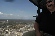 Mississippi SGovernor Haley Barbour flies in a huey helicopyter to survey the damage along the gulf coast Tuesday aug 30,2005.Wavelan was in Hancock county and was one of the hardest hit communities.(photo/Suzi Altman)