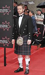 "Edinburgh International Film Festival, Sunday 26th June 2016<br /> <br /> Stars turn up on the closing night gala red carpet for the World Premiere of ""Whisky Galore!""  at the Edinburgh International Film Festival 2016<br /> <br /> Sean Biggerstaff who plays Sergeant Odd in the film.<br /> <br /> (c) Alex Todd   Edinburgh Elite media"