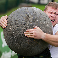 Competitor lifts a stone ball in the Highland Game competition held at the FitParade mass sports event in Budapest, Hungary on October 17, 2015. ATTILA VOLGYI