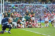 Japan's Captain Michael Leitch scores a try during the Rugby World Cup Pool B match between South Africa and Japan at the Community Stadium, Brighton and Hove, England on 19 September 2015. Photo by Phil Duncan.