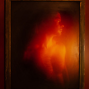 """""""BloodWorks, #4"""". 1 of 3.  20""""x24 archival pigment print mounted on metal, in an iron frame, with 2 gallons of UV acrylic resin poured over the top.  All of the """"red"""" toning in the print comes from the HIV+ blood filter mounted in front of the """"Untouchable"""" camera. Currently on exhibit at ArtisenWorks Rochester NY."""