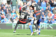 Cardiff City's Sean Morrison (c) is challenged by Qpr's Alejandro Furling (l) and Clint Hill (r). Skybet football league championship match, Cardiff city v Queens Park Rangers at the Cardiff city stadium in Cardiff, South Wales on Saturday 16th April 2016.<br /> pic by Carl Robertson, Andrew Orchard sports photography.