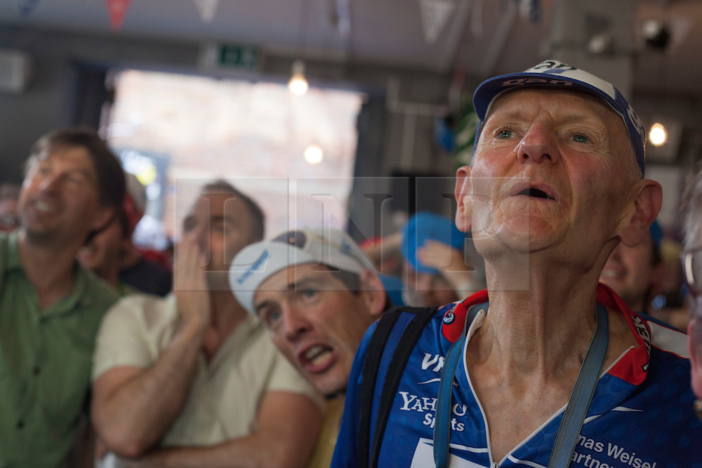 © licensed to London News Pictures. London, UK 22/07/2012. Supporters of Bradley Wiggins watching Tour de France's last minutes at Look Mum No Hands Cafe in central London. Bradley Wiggins becomes the first British rider to win the Tour de France. Photo credit: Tolga Akmen/LNP