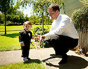 Groom Chris checks out his dapper ring bearer before his wedding in Napa, CA.