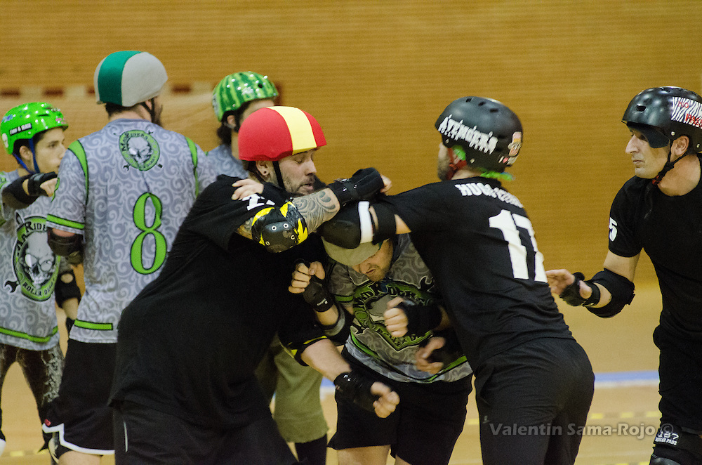 MADRID, SPAIN - January 23, 2016: Jammer of MadRiders, 237 Killer Manzano, trying to pass between two players of RockNRollaz during the match held in Madrid.