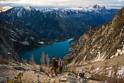 Hikers descend towards Colchuck Lake from Asgard Pass, Alpine Lakes Wilderness, Washington.