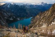 Hikers descend towards Colchuck Lake from Asgard Pass, Alpine Lakes Wilderness, Washington.