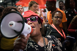 """vicky Magwecara demonstrates on July 20 for greater rights for sex workers at the 2016 International AIDS Conference in Durban, South Africa. """"Sex workers' rights are human rights"""", they chanted."""