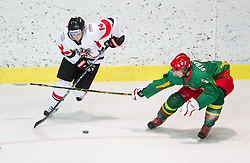 Fabio Hofer of Austria vs Artus Rybakov of Lithuania  during the ice hockey match between National teams of Lithuania (LTU) and Austria (AUT) at 2011 IIHF World U20 Championship Division I - Group B, on December 12, 2010 in Ice skating Arena, Bled, Slovenia.  (Photo By Vid Ponikvar / Sportida.com)