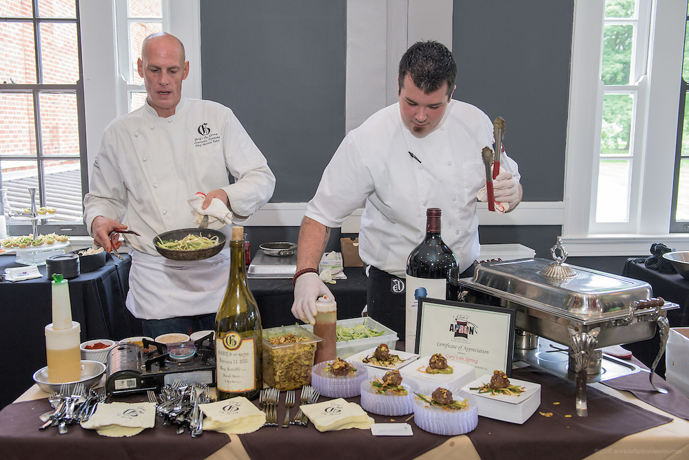 Executive Chef Harold Baker, left, and Sous Chef Zack Wolf of Gary's on Spring prepare another round of Chef Harold's Award Winning Meatballs at A Taste of Independents, a fundraiser for Apron, Inc., at The Olmsted on Frankfort Avenue. July 12, 2015