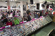 Customers browse CDs in hmv music shop in London Victoria railway station, United Kingdom.  HMV is a British entertainment retailing company that opened in 1921, but entered into administration in January 2013, which has led to many store closures.