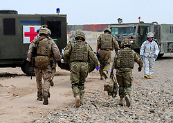 © Licensed to London News Pictures. 17/01/12. FILE PICTURE The MOD has announced Up to 2,900 Army, 1,000 RAF and 300 Royal Navy staff to be made redundant in latest UK defence cuts. 11/06/11. AFGHANISTAN. The team work on a casualty. The RAF Regiment's Medical Emergency Response Team (MERT) is made up of two teams based in 'Main Operating Base Bastion', they are responsible for extracting casualties from anywhere within Helmand Province.  The MERT consists of a doctor, an emergency department nurse and two paramedics.  In addition four Royal Air Force Regiment gunners provide armed protection when they land and leave the helicopter to collect the casualty.   Caption must read Alison Baskerville/LNP...