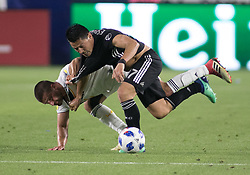 April 8, 2018 - Carson, California, U.S - Perry Kitchen #2 of the LA Galaxy battles for the ball with Roger Espinosa #17 of the Sporting Kansas City during their MLS game on Sunday April 8, 2018 at the StubHub Center in Carson, California. LA Galaxy loses to Sporting, 2-0. (Credit Image: © Prensa Internacional via ZUMA Wire)