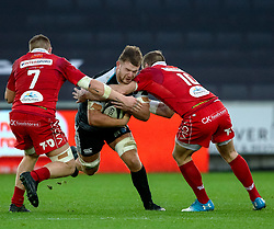 Olly Cracknell of Ospreys is tackled by Hadleigh Parkes of Scarlets<br /> <br /> Photographer Simon King/Replay Images<br /> <br /> Guinness PRO14 Round 11 - Ospreys v Scarlets - Saturday 22nd December 2018 - Liberty Stadium - Swansea<br /> <br /> World Copyright © Replay Images . All rights reserved. info@replayimages.co.uk - http://replayimages.co.uk