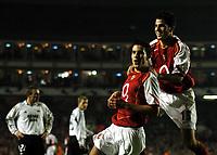 Photo: Javier Garcia/Back Page Images Mobile +447887 794393 Arsenal v Rosenborg, UEFA Champions League 07/12/04, Highbury<br />Robin Van Persie celebrates number five with Cesc Fabregas