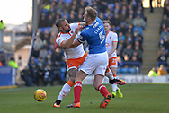 Blackpool Forward, Kyle Vassell (7) and Portsmouth Defender, Matt Clarke (5) come together during the EFL Sky Bet League 1 match between Portsmouth and Blackpool at Fratton Park, Portsmouth, England on 24 February 2018. Picture by Adam Rivers.