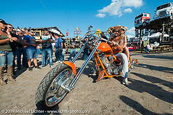 Feleisha Grider and Ferrel Price at the Full Throttle Saloon during the annual Sturgis Black Hills Motorcycle Rally. SD, USA. August 7, 2014.  Photography ©2014 Michael Lichter.