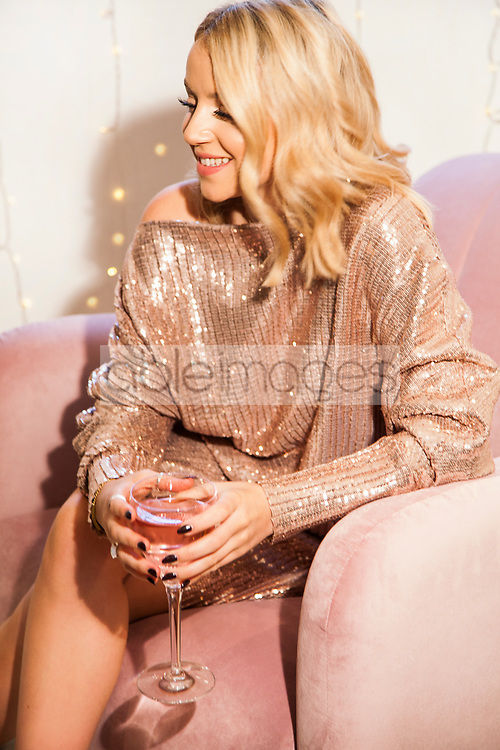 Woman Sitting on Armchair having a Cocktail