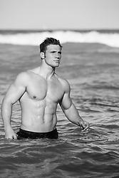 shirtless man in the ocean