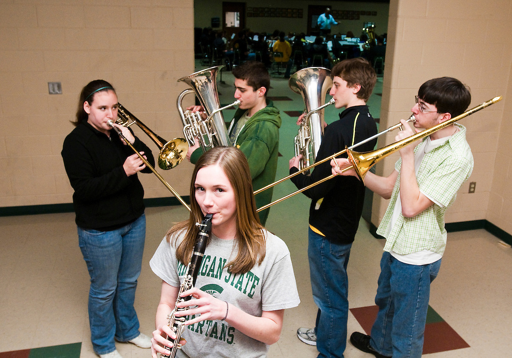 Matt Dixon | The Flint Journal..Goodrich High School brass quartet players, (from left), Tricia Harrris, 15, a Sophomore trombone player, Tyler Monroe18, a senior euphonium player, Steve Patterson, 15, a sophomore euphonium player, and Paul Johnson, 17, a senior trombone player, pose for a portrait during band practice Tuesday afternoon. The four were part of a limited group to be selected to audition for the Michigan Arts Festival.