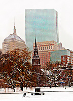 Boston on a snowy day with a lone skater