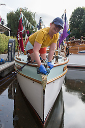 © Licensed to London News Pictures.  03/09/2021. London, UK. Rachel Turner prepares the boat called Crest at St Katharine Docks Martina on the River Thames ahead of the Classic Boat Festival this weekend. With 40 vintage sail and motor yachts, the Classic Boat Festival is part of Totally Thames' 25th festival. Photo credit: Marcin Nowak/LNP