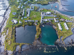 Drone view of flooded slate quarries on Easdale Island on one of the slate islands, Argyll and Bute, Scotland, UK