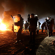 """Riot police clash with residents in """"The Jungle"""" migrant camp in Calais , northern France"""