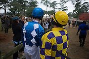 Colonial Cup - Camden, South Carolina. Darren Nagle speaks to another jockey in the paddock.