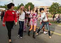 LHS Sophomore got into the 1970's mod squad spirit during the Homecoming parade Friday afternoon.  (Karen Bobotas/for the Laconia Daily Sun)