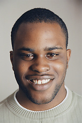 Portrait of young man smiling,