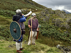 August 27, 2017 - Buttermere, Cumbria, United Kingdom - Image ©Licensed to i-Images Picture Agency. 27/08/2017. Buttermere, United Kingdom. Viking history re-enactors mark the Battle of Rannerdale. The group dressed as Vikings from Moorforge Viking settlement in Cumbria climbed Rannerdale in the Lake District. Rannerdale is the spot where an army of Vikings made up of Norsemen and native Britain's ambushed and defeated the Norman Army some 50 years after the Norman Conquests of 1066. The valley above Crummock Water is famed for its display of bluebells in spring. The legend has it that the bluebells bloom so well due to the blood spilled on the earth all those years ago. Picture by Stuart Walker / i-Images (Credit Image: © Stuart Walker/i-Images via ZUMA Press)