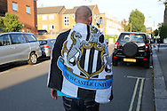 a Newcastle United fan walking outside Loftus Road before k/o. EFL Skybet football league championship match, Queens Park Rangers v Newcastle Utd at Loftus Road Stadium in London on Tuesday 13th September 2016.<br /> pic by John Patrick Fletcher, Andrew Orchard sports photography.