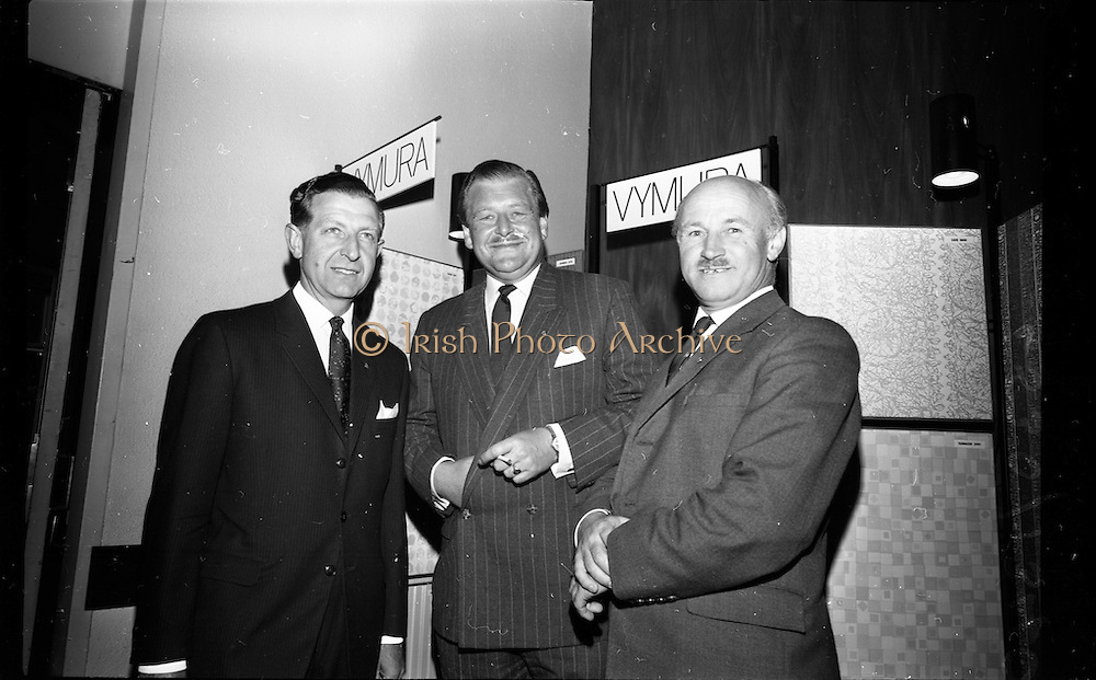 """23/06/1965<br /> 06/23/1965<br /> 23 June 1965<br /> I.C.I. (Imperial Chemical Industries) """"Vymura""""  luxury wall covering (wallpaper?) demonstration at the Intercontinental Hotel, Dublin. Pictured at the event were (l-r) Mr. D.W. Moore, (Paints Division) I.C.I.; Mr. T.P. casey, Commercial Director, I.C.I. (Ireland) `Ltd. and Mr. J.K.D. Lacey, Sales Manager, I.C.I. (Ireland) Ltd."""