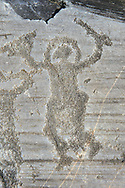 Petroglyph, rock carving, of a warriors with a helmet, small round shield and sword. Carved by the ancient Camunni people in the iron age between 1000-1200 BC. Rock no 24, Foppi di Nadro, Riserva Naturale Incisioni Rupestri di Ceto, Cimbergo e Paspardo, Capo di Ponti, Valcamonica (Val Camonica), Lombardy plain, Italy .<br /> <br /> Visit our PREHISTORY PHOTO COLLECTIONS for more   photos  to download or buy as prints https://funkystock.photoshelter.com/gallery-collection/Prehistoric-Neolithic-Sites-Art-Artefacts-Pictures-Photos/C0000tfxw63zrUT4<br /> If you prefer to buy from our ALAMY PHOTO LIBRARY  Collection visit : https://www.alamy.com/portfolio/paul-williams-funkystock/valcamonica-rock-art.html