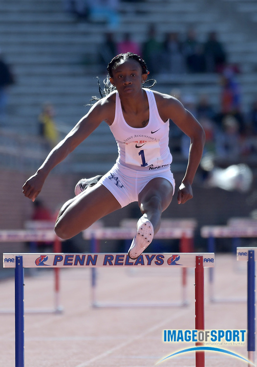 Apr 26, 2018; Philadelphia, PA, USA; Shannon Kalawan of St. Augustine's wins the college women's 400m hurdles in 57.30 during the 124th Penn Relays at Franklin Field.