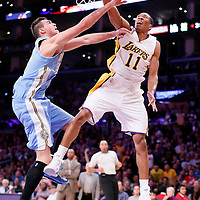 23 November 2014: Los Angeles Lakers forward Wesley Johnson (11) dunks the ball over Denver Nuggets forward Danilo Gallinari (8) during the Los Angeles Lakers season game versus the Denver Nuggets, at the Staples Center, Los Angeles, California, USA.