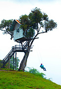 """Fog surrounds the """"Swing At The End Of The World"""", an adventure destination in Banos, Ecuador. The swing carries the swinger out over a deep mountainous canyon and is attached to a treehouse called La Casa del Arbol. The treehouse was constructed many years ago to monitor the Tungurahua Volcano."""
