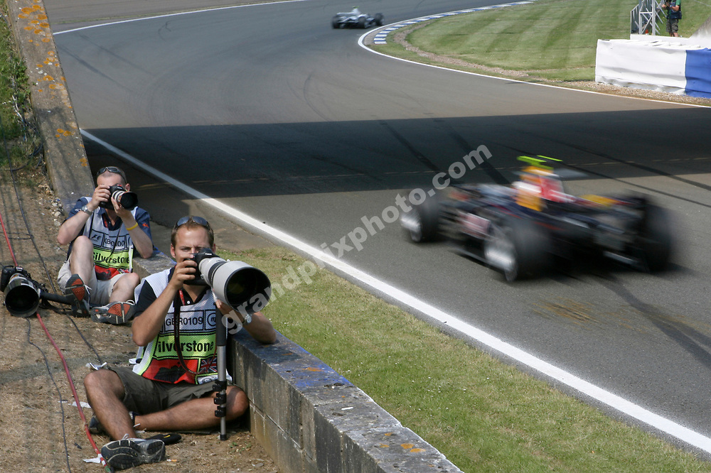Photographers at work during Friday's practice for the 2006 British Grand Prix at Silverstone. Photo: Grand Prix Photo