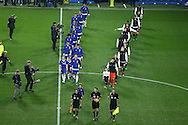 The players from both teams and the match officials walk onto the pitch for the start of the game. Premier league match, Chelsea v Tottenham Hotspur at Stamford Bridge in London on Saturday 26th November 2016.<br /> pic by John Patrick Fletcher, Andrew Orchard sports photography.