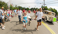 """The crowd gathered for the Gilmanton 4th of July festivities were treated to """"A Little Thistle and That Farm"""" marchers along the parade route on Wednesday morning.  (Karen Bobotas/for the Laconia Daily Sun)"""