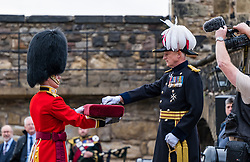 Installation of Edinburgh Castle Govenor, Edinburgh Castle, Edinburgh, Scotland, United Kingdom 23  June 2021: <br /> nstallation as Governor of Edinburgh Castle: the dress rehearsal takes place for the ceremony which will be held tomorrow, two years after the handover of the position to Maj Gen Alastair Bruce of Crionaich.  The ceremony was delayed due to Covid-19. The role of Governor is a historic one, dating back to 1067. Maj Gen Bruce is also a Sky News commentator. Representative form all Scottish military regiments are involved, in a ceremony that takes a new curtailed form only within the castle due to Covid restrictions. Pictured: the new Governor receives the key to the castle. <br /> Sally Anderson | EdinburghElitemedia.co.uk