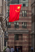 The Chinese national flag hangs outside the Bank of China in the City of London.