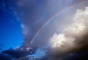 Blue sky and clouds and rainbow.
