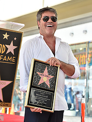 Simon Cowell receives a star on the Hollywood Walk of Fame. 22 Aug 2018 Pictured: Simon Cowell. Photo credit: AXELLE/BAUER-GRIFFIN / MEGA TheMegaAgency.com +1 888 505 6342