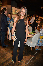 NATHALIE SCHYLLERT at a party to celebrate the publication of 'Feeding The Future' by Lohralee Astor and Tali Shine held at OKA, 155-167 Fulham Road, London on 8th June 2016.